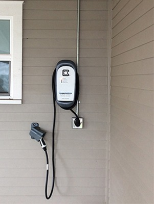 HCS-40 charging station outside tan house
