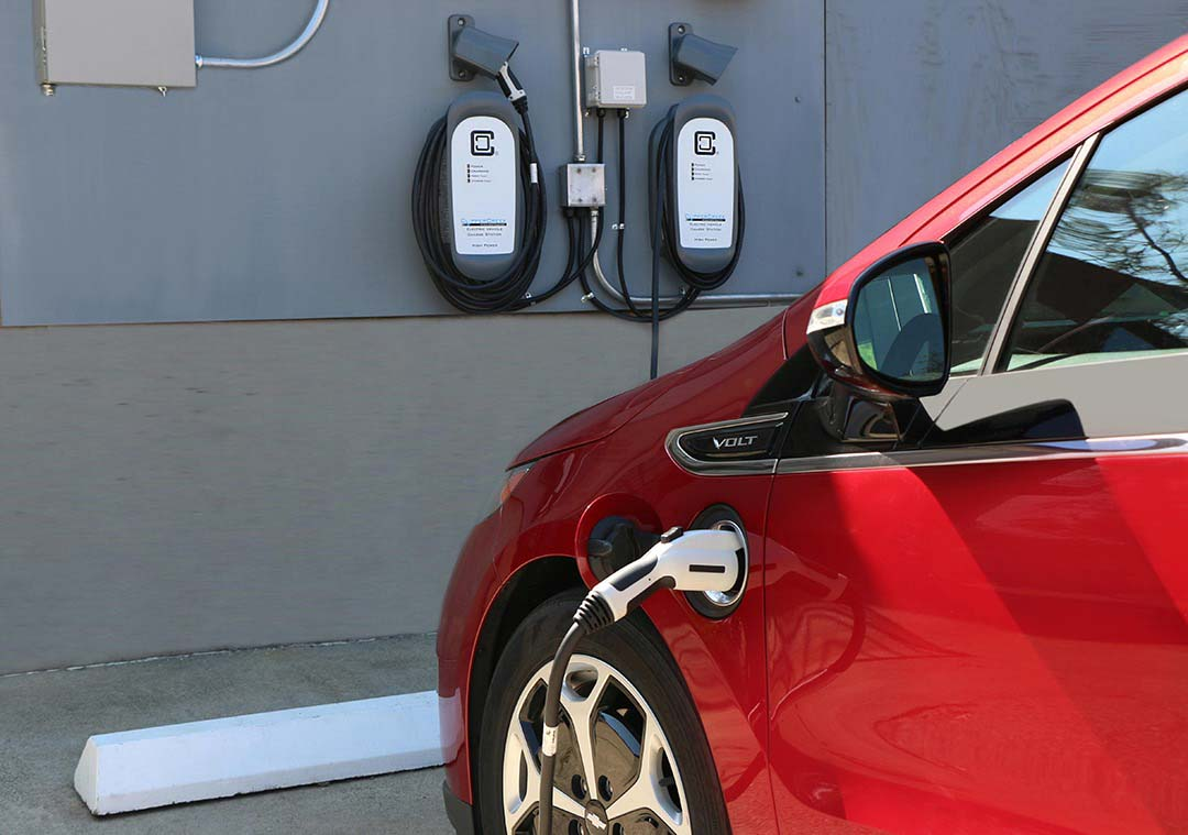 COSMOS Charging red Chevy Volt with ClipperCreek electric car charging station
