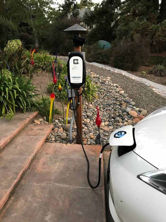 HCS-40 with ChargeGuard with white Nissan Leaf closeup