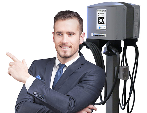 handsome smiling business man pointing and posing next to workplace clippercreek charger